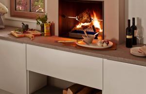 Brunner Urfeuer 50/66 кухонный камин с грилем.